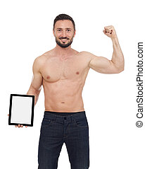 Muscular man with digital tablet