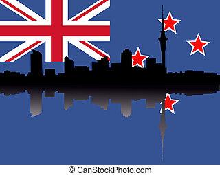 Auckland skyline with flag - Auckland skyline reflected on...