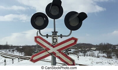 Traffic lights at a railway crossing.