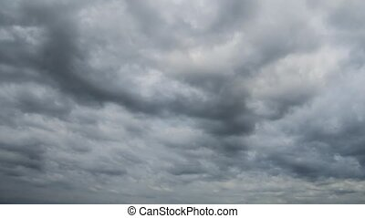 Timelapse thunder sky with white cumulus clouds above the...