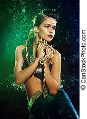 Young girl at the image of mermaid - Young beautiful girl at...