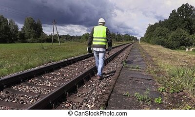 Railroad worker walking and checking railway
