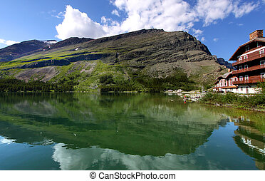 Swiftcurrent lake - Reflections of mountains and resort near...