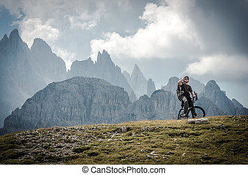 High Mountains Bike Ride. Caucasian Sportsman on the Ride...
