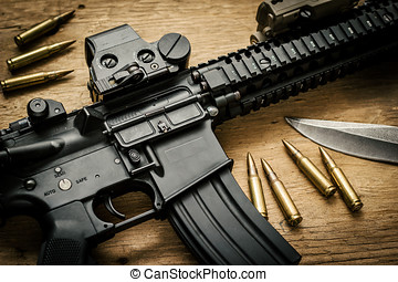 assault rifle and bullets on the table - assault rifle and...