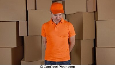Courier in orange uniform delivering damaged parcel to...