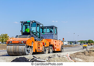Steamrollers are parked at building site. Machinery for road construction