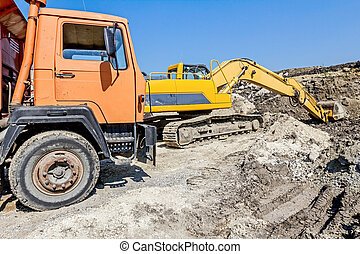 Dump truck cabin - Heavy wheels are working at construction...