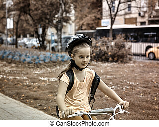 Child ride on bicycle. Toned image. - Bikes bicyclist girl....