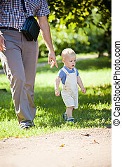 Father with son walking