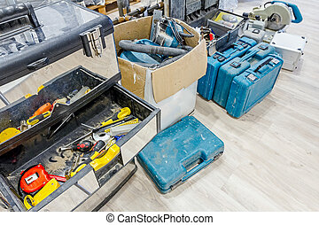 Plastic tool boxes on laminate floor with equipment for furnishing