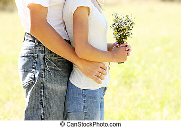 happy couple in love with a bouquet