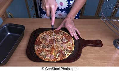 Woman trying to split pizza