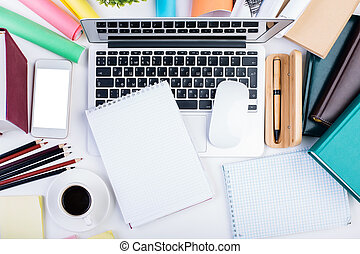 Desktop with supplies and technology - Top view of creative...