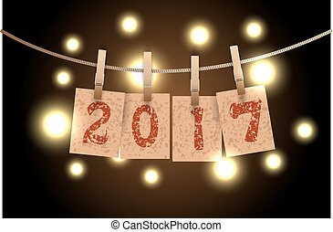 New year word in paper grunge panels hanging on rope by...