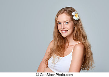 Beautiful young woman with flower in hair - Beautiful...