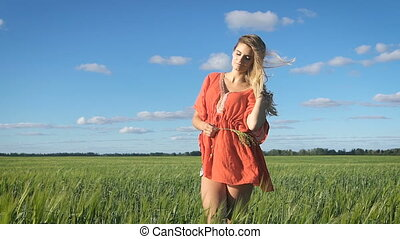 Beautiful young blond woman with the sexy look standing and...
