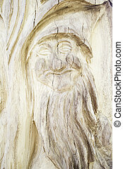 Elf carved tree with happy face, emotion