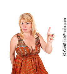 Blond woman pointing finger - A portrait image of a blond...