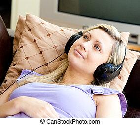 blond woman asleep listening music - blond woman asleep...