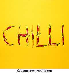 Red hot chili peppers on yellow background making word quot;...