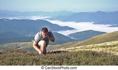 Man picking and eating blueberries - Bearded man in the...