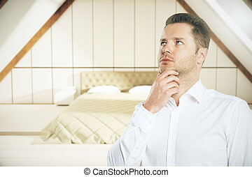 Thinking man in bedroom - Portrait of thoughtful european...