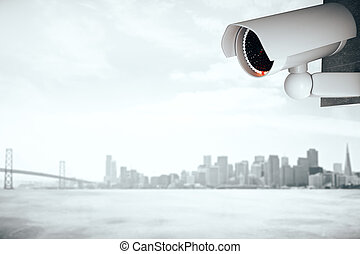 Security camera on foggy city background