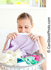 Cute woman doing her laundry at home