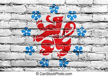 Flag of the German-speaking Community of Belgium, painted on brick wall
