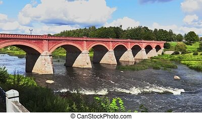 Old stone bridge over the river in summer
