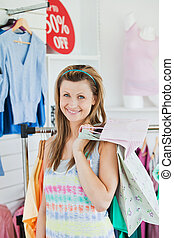 Smiling woman choosing clothes
