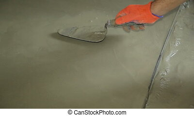 Construction work site. - Construction Worker Smoothing Out...