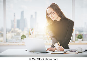 Beautiful woman working on project