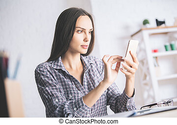 Beautiful woman using smartphone - Beautiful young woman...