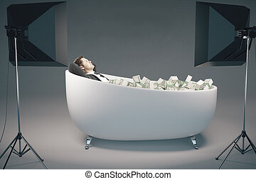 Success concept - Young businessman relaxing in bathtub...