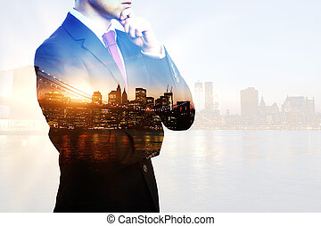 Businessperson on city background multiexposure - Creative...