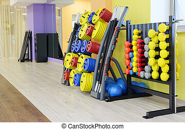 fitness hall with dumbbells