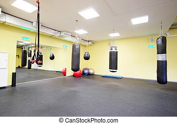 fitness hall with punching bags - Interior of a fitness hall...