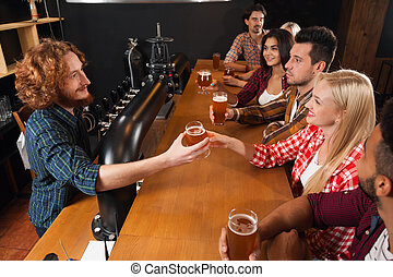 Young People Group In Bar, Barman Give Beer, Friends Sitting...