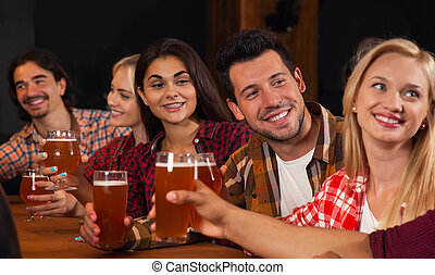 Young People Group In Bar, Hold Beer Glasses Speaking,...