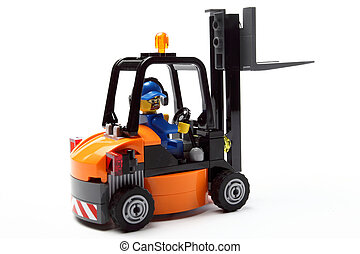 toy man on forklift truck a - toy man on forklift truck on a...