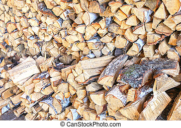 woodpile background - birch firewood put in woodpile...