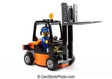 toy man on forklift truck c - toy man on forklift truck on a...