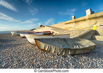 Fishing Boats at Chesil Cove - Fishing boats under a blue...