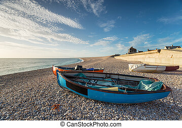 Boats at Chesil Cove - Fishing boats on Chesil Beach at the...