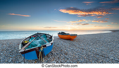 Boats on a Pebble Beach - Boats at Chesil Cove on the Isle...