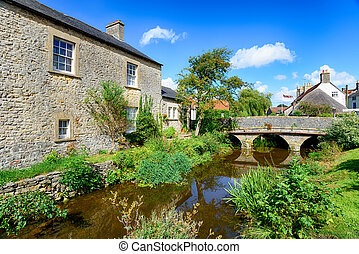 Nunney in Somerset - Pretty cottages and a bridge over the...