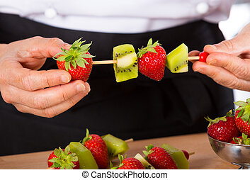 Chef with fruits - Chef preparing a variety of mixed fruit...