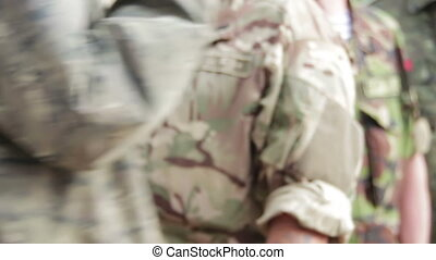 Army Military are in Camouflage Uniforms. Background of the...